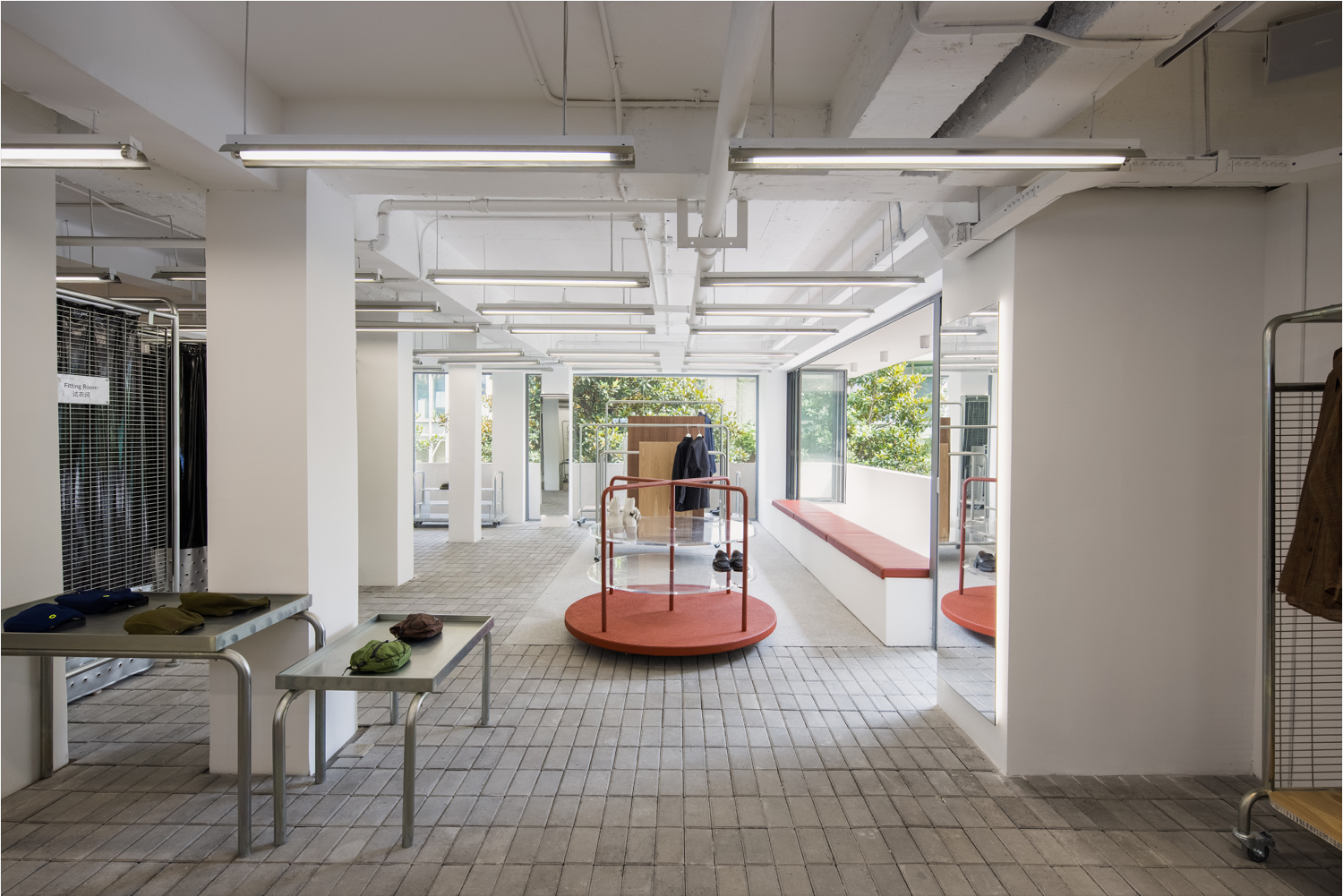 A metal carousel in the middle of the store deliberately recalls the kind found in children's playgrounds across the globe