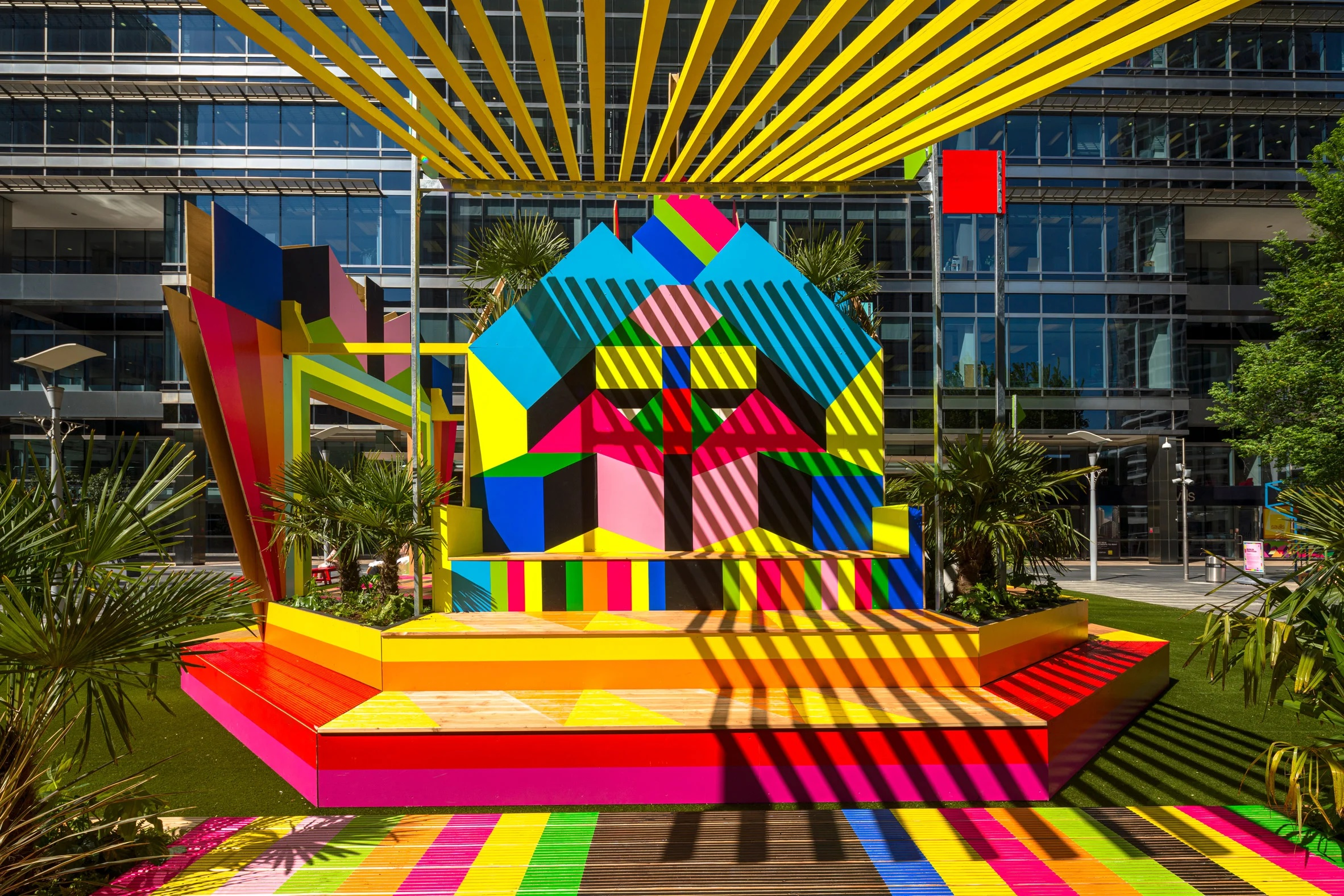 Sun Pavilion introduces Morag Myerscough's trademark neon colours and geometric shapes to London's Montgomery Square.