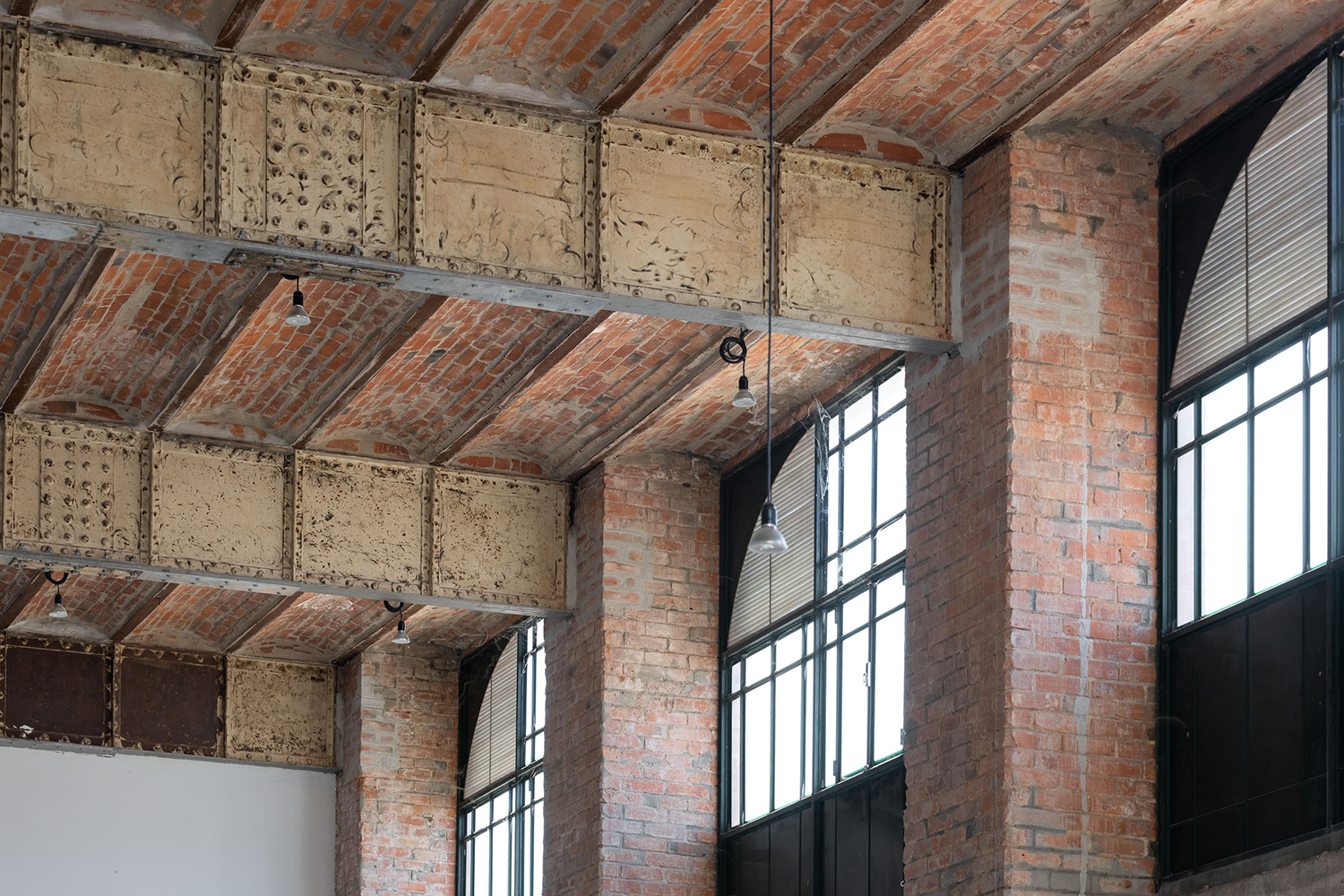 A close up of the barrel-vaulted brickwork and  rugged steel beams
