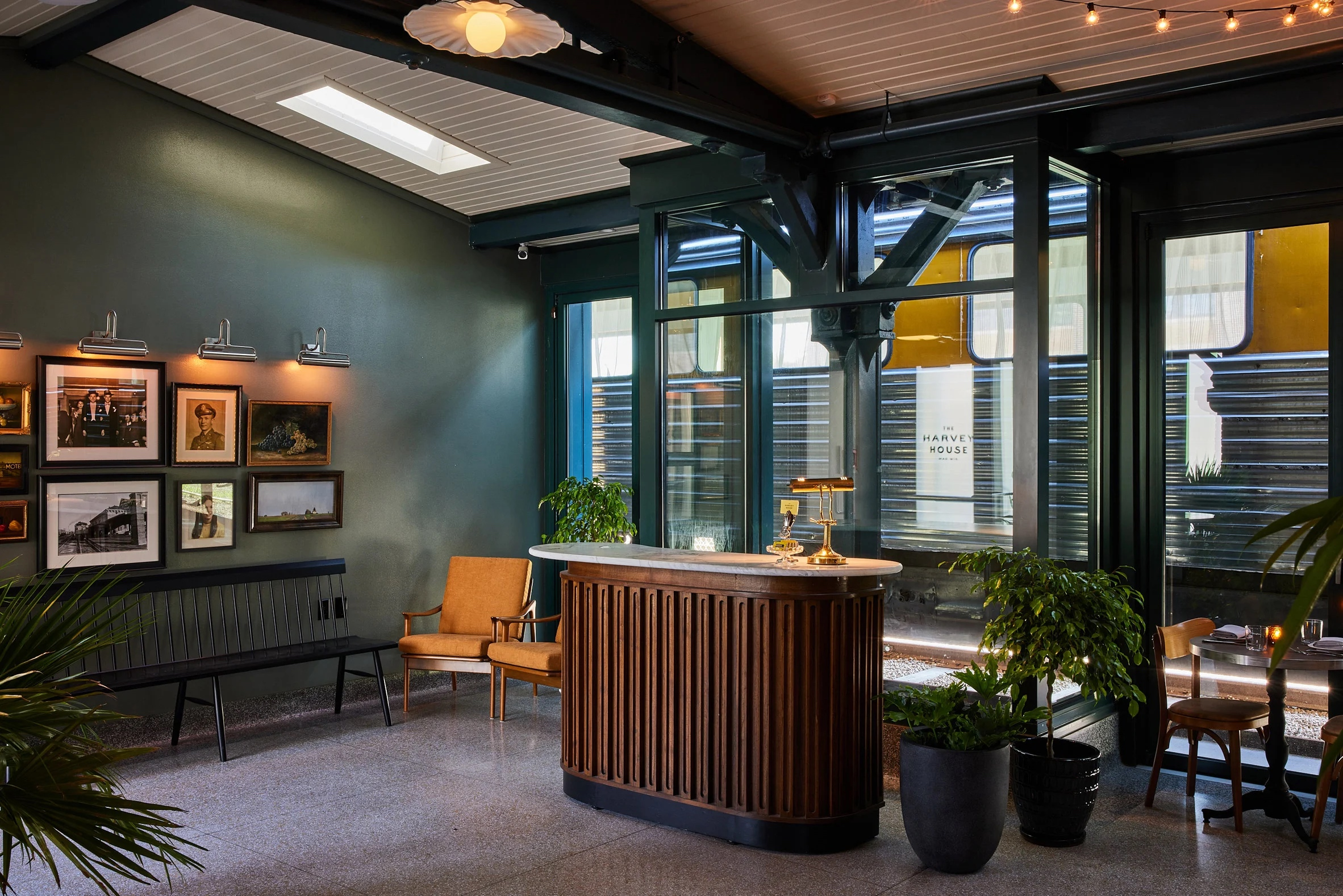 The colour palette reflects the golden age of the railway, with dark woods and heritage green shades