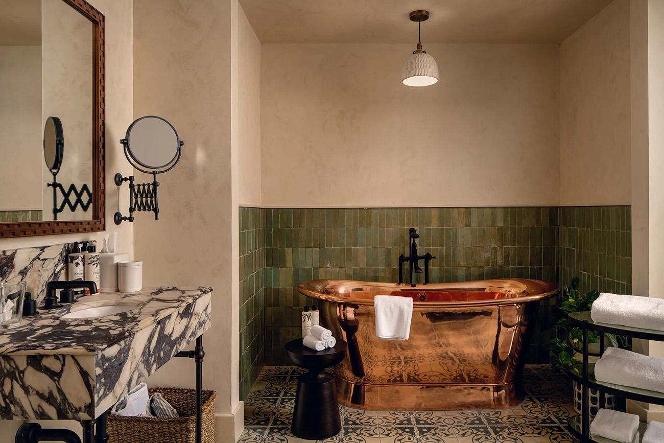 A copper rolltop bath