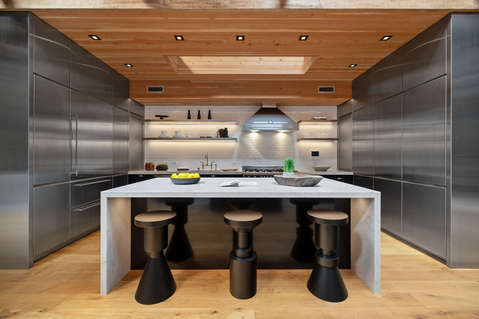 Stainless steel appliances and marble countertops in the kitchen