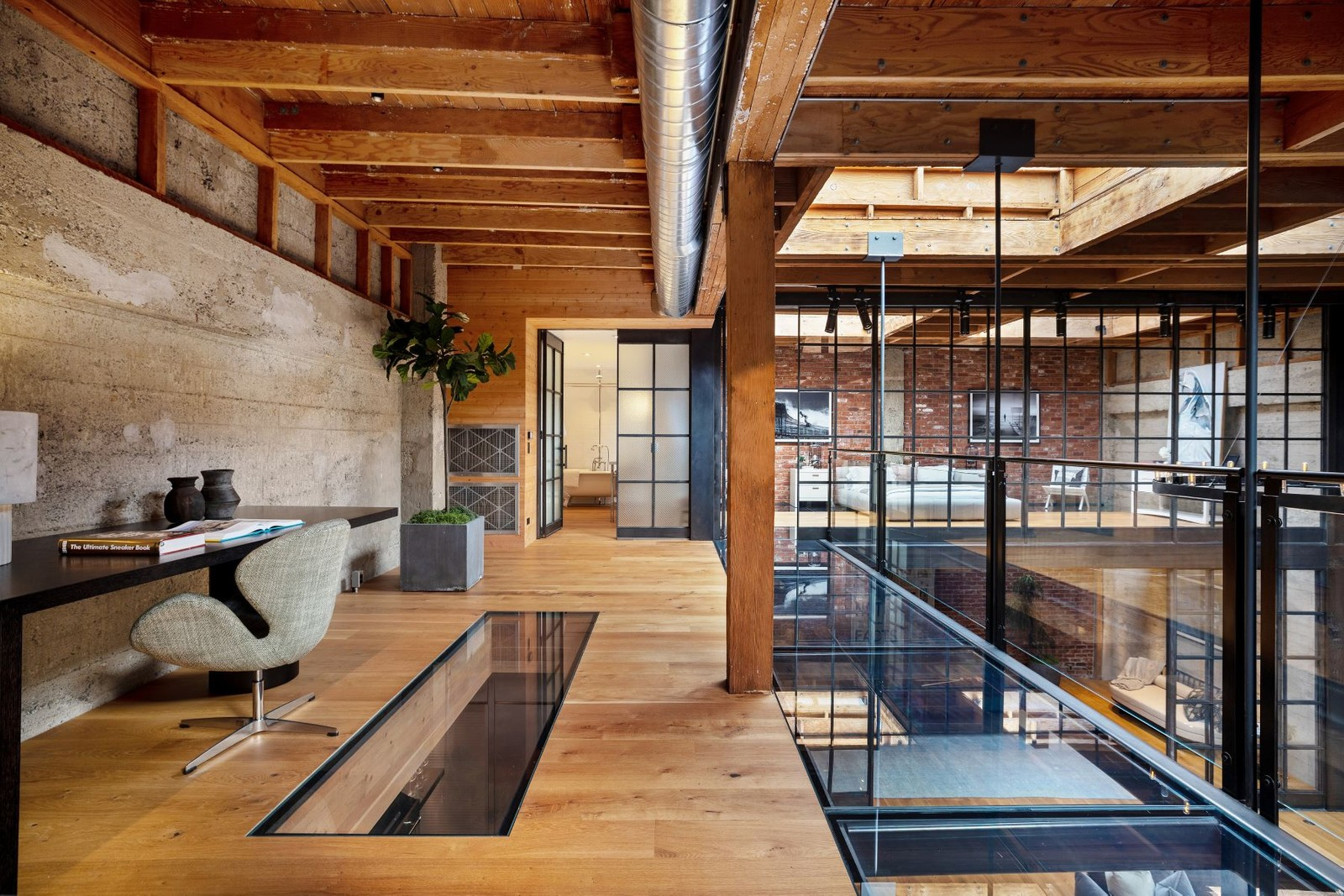 Crittall glass and wall partitions create lightflow across the three-storey property. On the mezzanine, a glass floor plate acts in a similar fashion, funnelling light into the space below