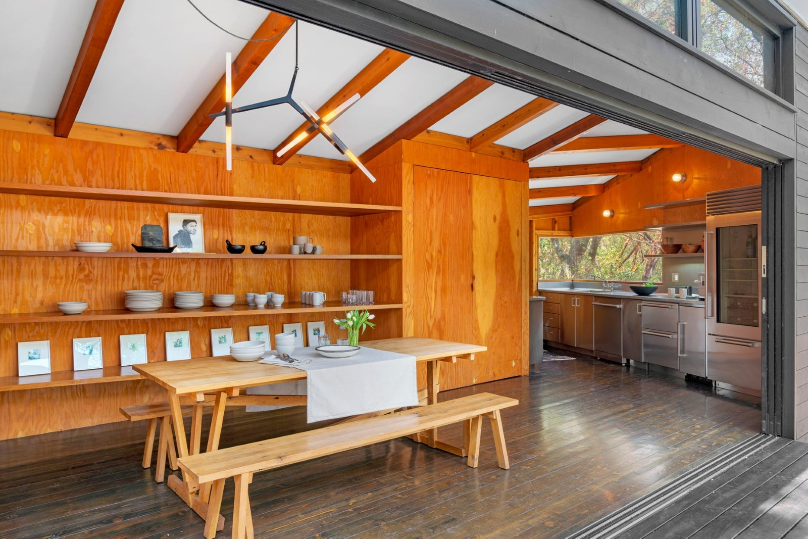The Forest Home sits on a 40-acre estate near Healdsburg and comprises a cluster of angular, interconnected cabins that unfurl as a series of private and public indoor/outdoor spaces.
