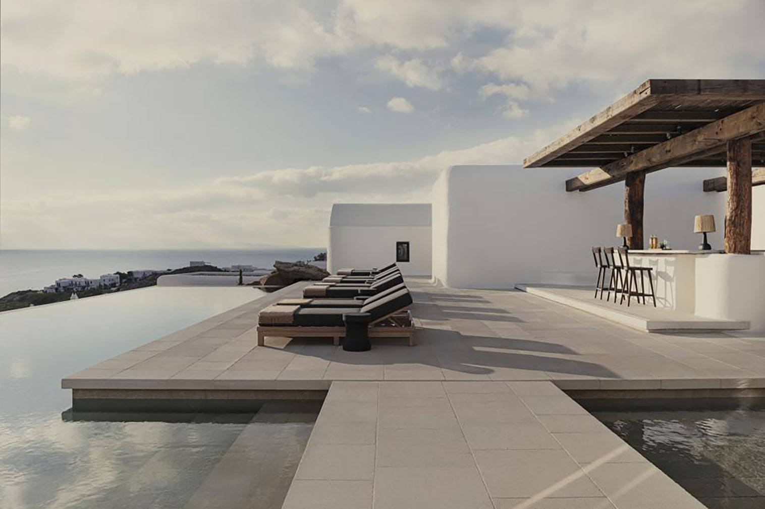 The rustic minimalism of Kalesma, Mykonos blends cycladic design with clean lines, concrete and reflective pools