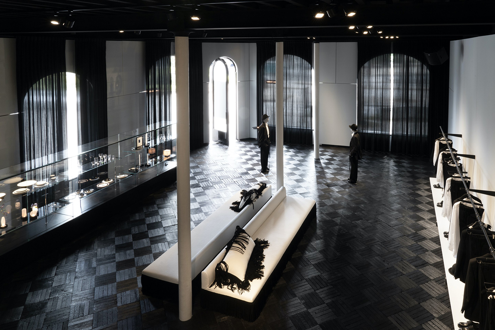 Demeulemeester's husband, Patrick Robyn, designed the two-storey retail space, which fully embraces the label founder's gothic reputation with its inky black floor and ceiling
