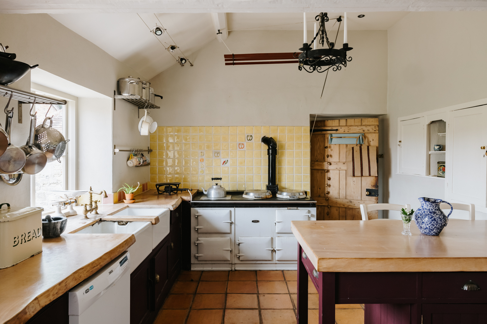 The kitchen has an old aga, wooden work tops and a serving hatch that connects to the dining room