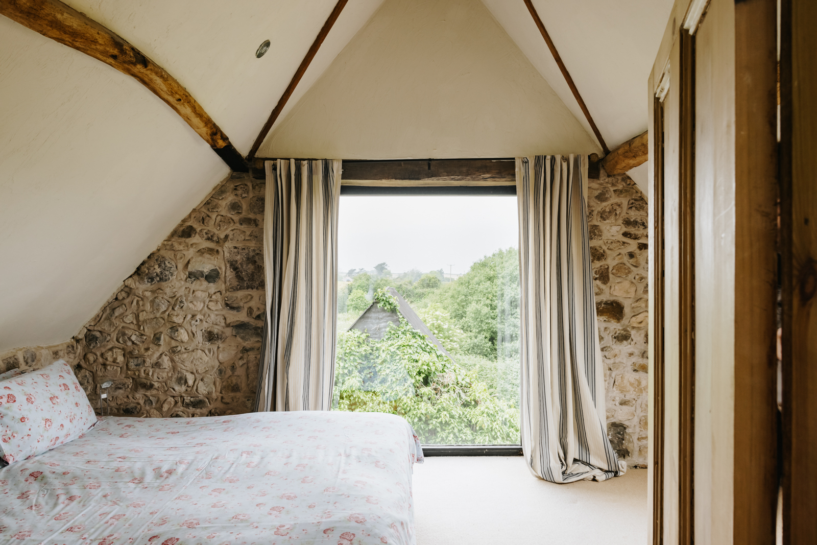 One of seven bedrooms with views across the wooded hillside