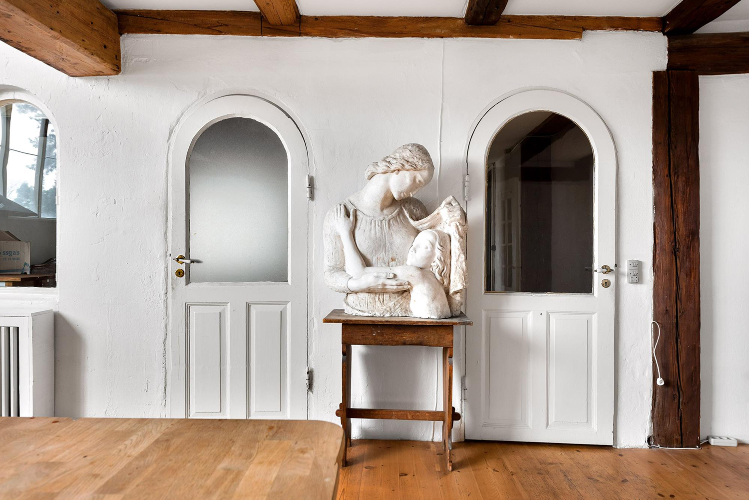 Arched doors are from the Old Eastern gaworks and continue the monastic feel
