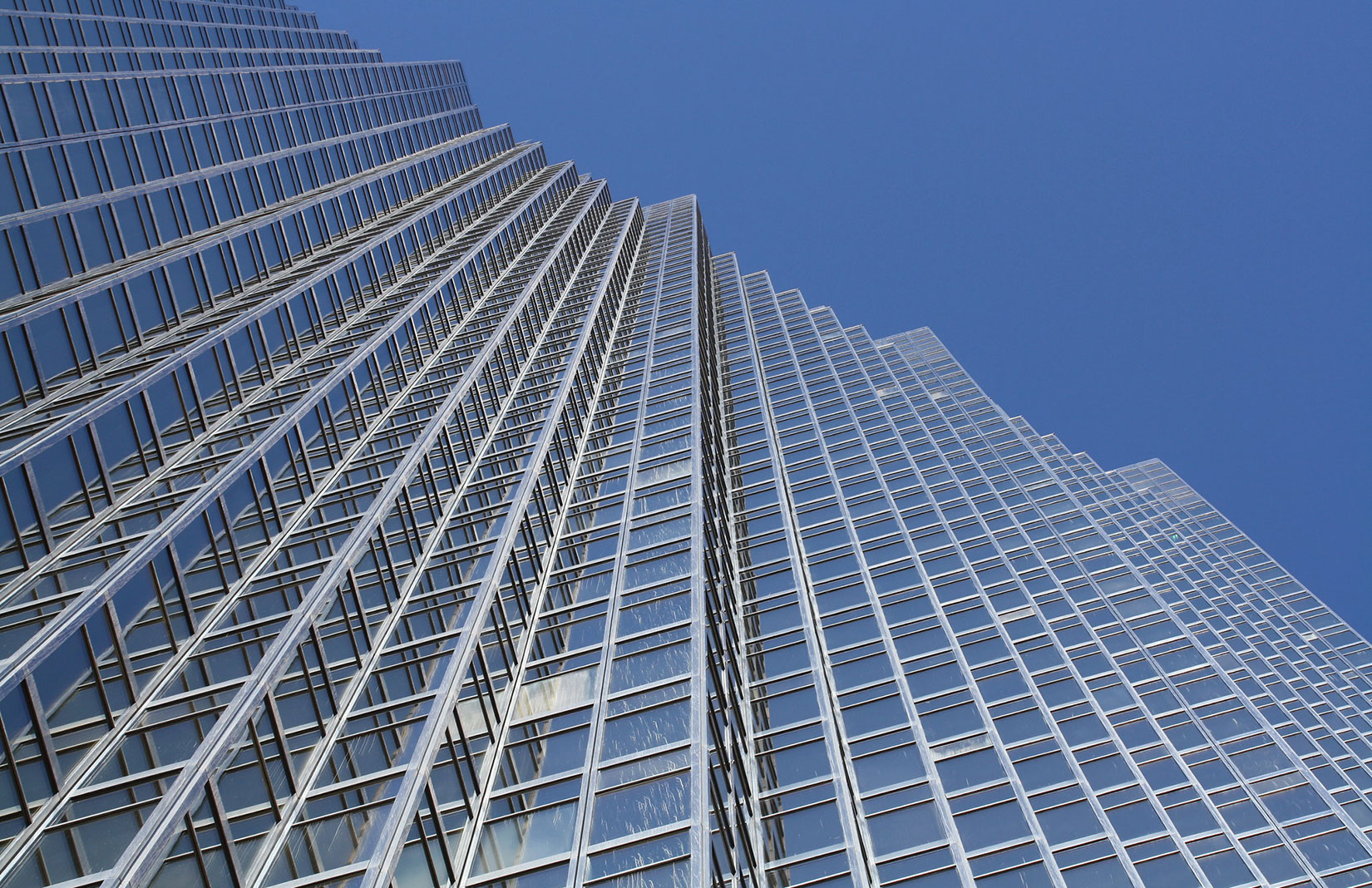 The RBC Plaza's sawtooth facade glistens thanks to flecks of gold in its glass windows