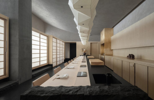 Origami lighting and rammed earth enliven this Shenzhen sushi restaurant