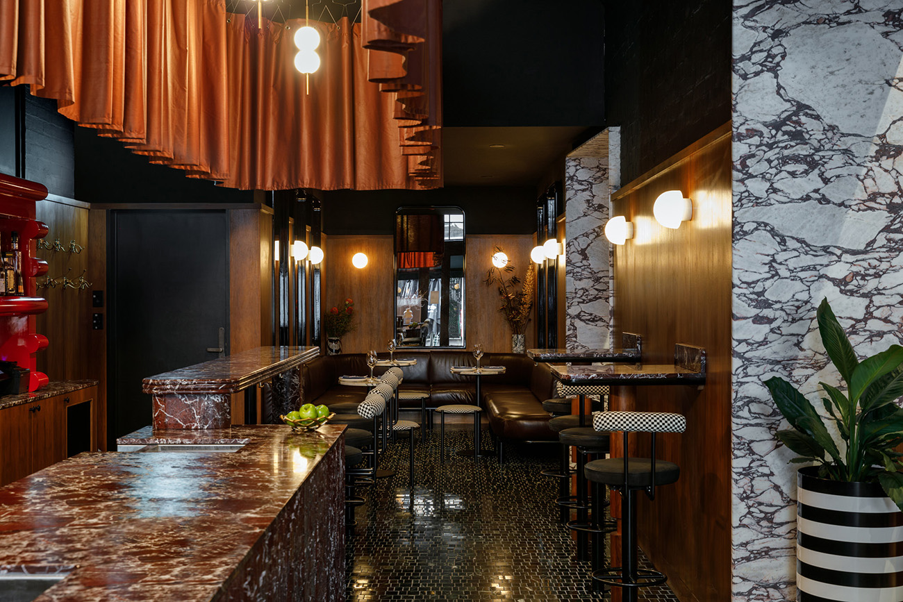 With a touch of Memphis, a hint of French bistro and a nod to Italian charm, local designers Studio Gram took a 'more is more' approach to Fugazzi's creating interiors.