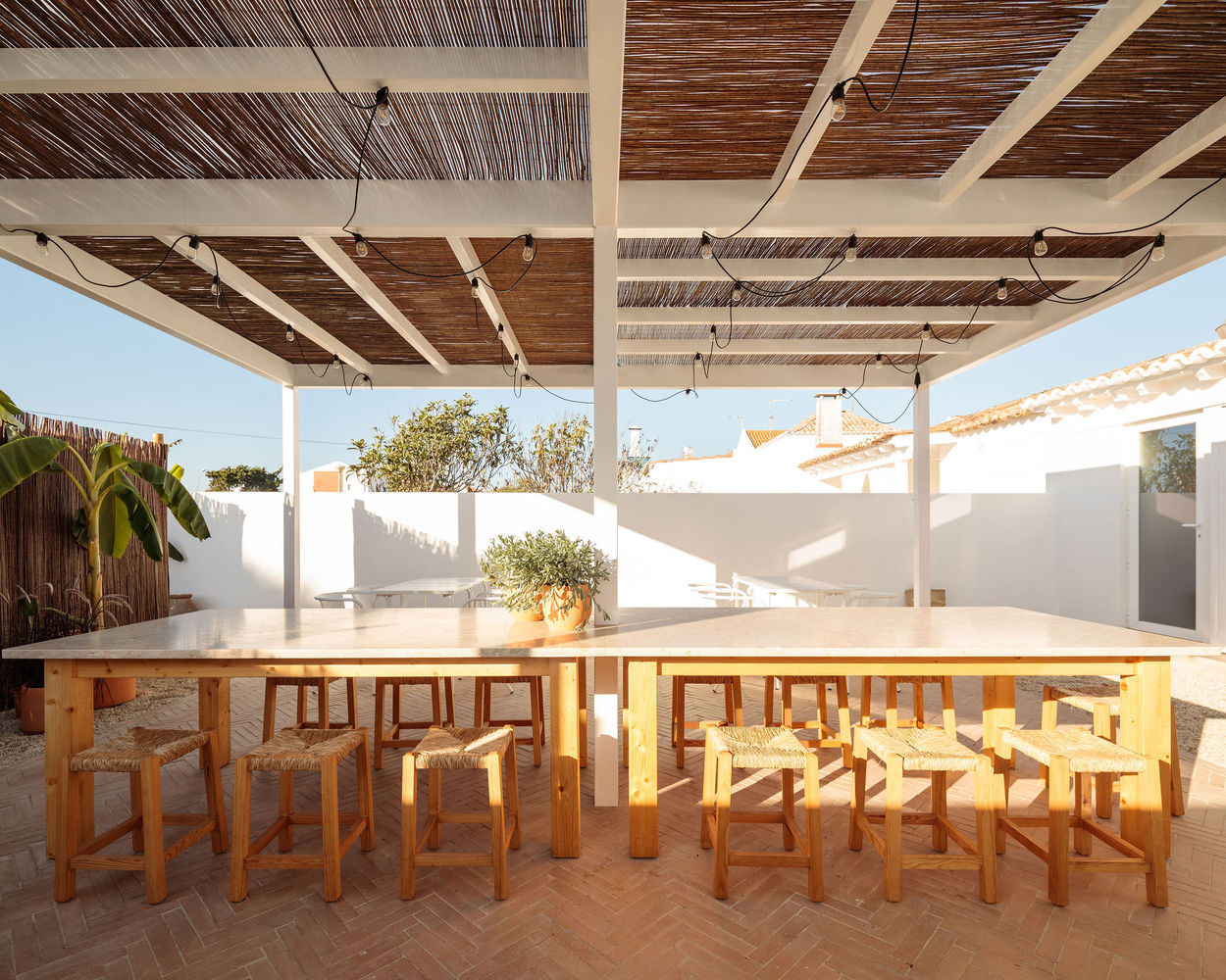 Whitewashed bamboo and exposed timber bring a homey vibe to this airy restaurant, located at the heart of a fishing village on Portugal's western Alentejo coast.