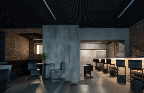 Prague's Studio Krymská opens to reveal raw, brooding interiors