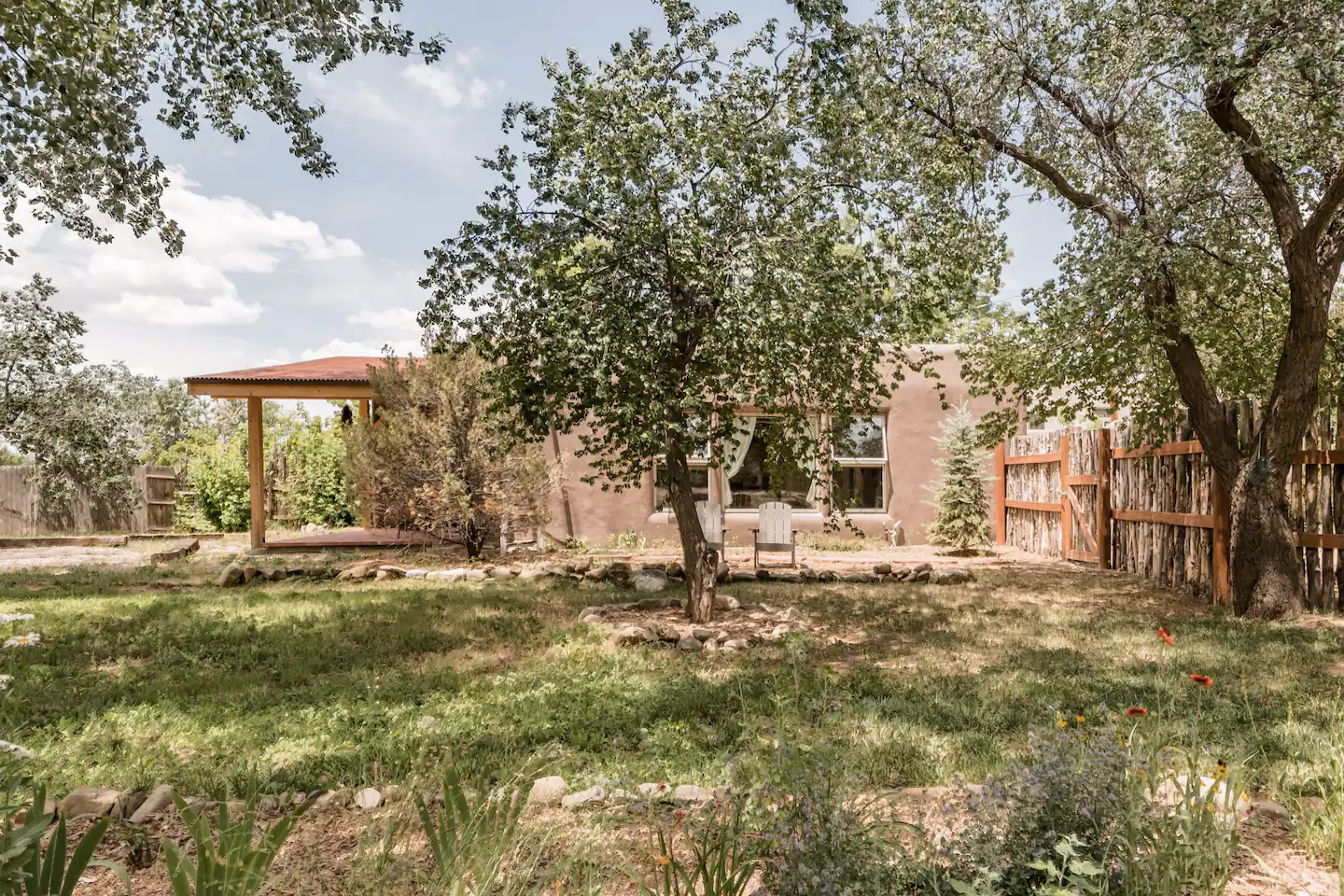 This traditional Adobe (earth clay) home is surrounded by orchards while interiors have a vintage 1970s vibe